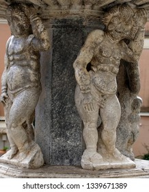 TAORMINA, SICILY - NOV 29, 2018 - Cherubs holding up a fountain in Taormina, Sicily, Italy