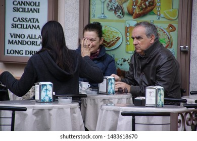 TAORMINA, SICILY - NOV 29, 2018 - People drink coffee in a cafe in Taormina, Sicily, Italy