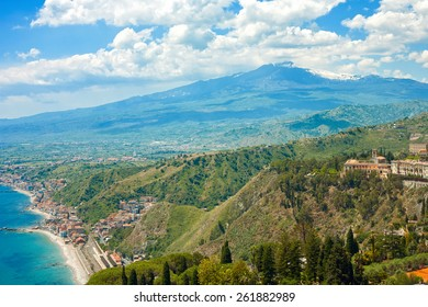 Taormina's Giardini-Naxos bay with the sea and the Etna and Catania in the back in Sicily, italy.