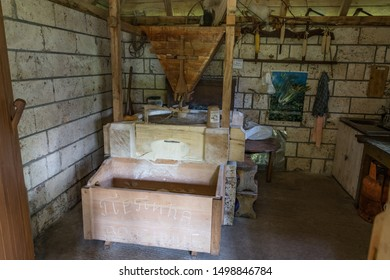 Taorska Vrela, Serbia / 06.22.2019 / Interior of a old water mill, Round mill stone grinding corn, organic food, the old-fashioned way of making flour