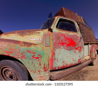 Taos, NM / USA -  11/25/2011: Weathered colorful vintage pickup truck with southwest gritty feel  style