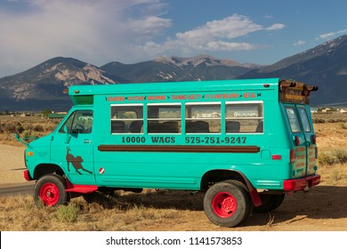 TAOS, NM, USA-7 JULY 18: 10,000 Wags, a pet boarding, daycare and grooming facility, uses this converted van to advertise on US 64, outside of Taos.
