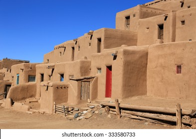 The Taos pueblo, with its colorful doors, is a popular tourist destination in northern New Mexico.