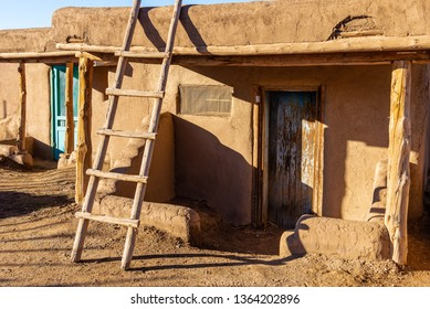 TAOS PUEBLO, NEW MEXICO / UNITED STATES - NOVEMBER 19, 2015: A still-inhabited  traditional adobe house in the centuries-old Native American settlement of Taos Pueblo.