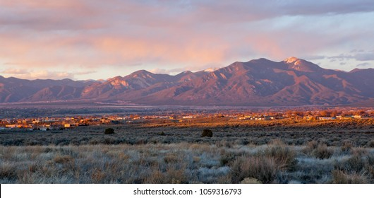 Taos Valley, New Mexico at sunset viewed from Llano, with Sangre de Cristo Mountains in the background