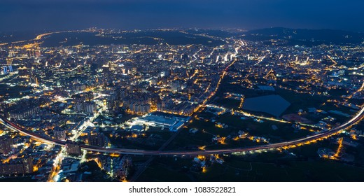 Taoyuan City Skyline Aerial View - Asia modern business city, panoramic cityscape (night view) birds eye view use the drone in evening, shot in Taoyuan, Taiwan.