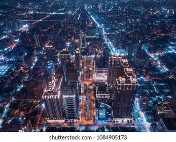 Taoyuan City Skyline Aerial View - Asia modern business city, cityscape (night view) birds eye view use the drone at night, shot in Taoyuan Arts Plaza, Taoyuan, Taiwan.