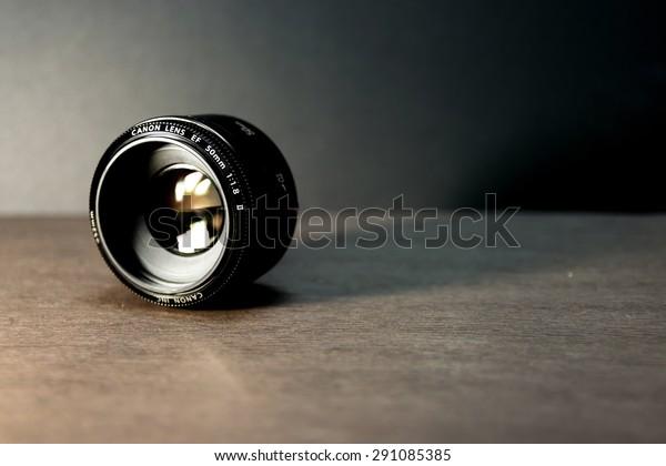 Taoyuan City,Taiwan - June 27, 2015: Very popular Canon EF 50mm f/1.8 II lens on black background