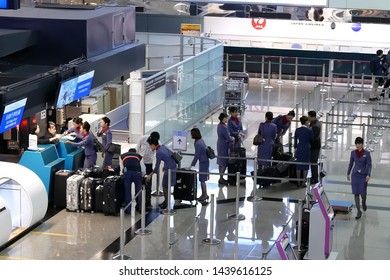 Taoyuan, Taiwan - January 25, 2019 : Top shot of passengers going to the China airline check in desks inside Taiwan airport