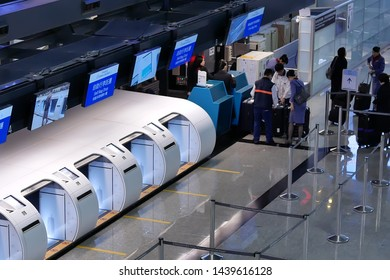 Taoyuan, Taiwan - January 25, 2019 : Top shot of self bag drop section and passengers going to the China airline check in desks inside Taiwan airport