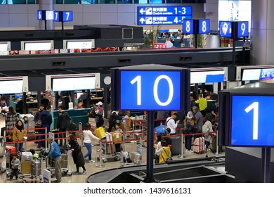 Taoyuan, Taiwan - January 25, 2019 : Top shot of passengers going to the check in desks inside Taiwan airport