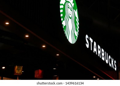 Taoyuan, Taiwan - January 25, 2019 : Close up of Starbucks logo on dark night