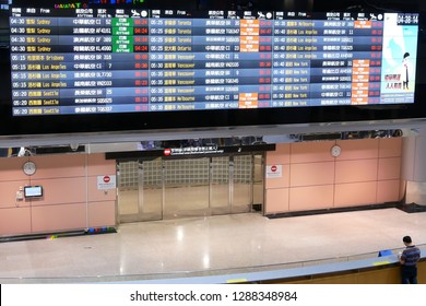 Taoyuan, Taiwan - November 07, 2018 : Close up of flight schedules board and terminal gate inside Taoyuan international airport in Taoyuan Taiwan