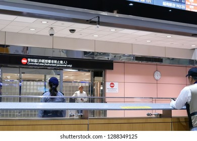 Taoyuan, Taiwan - November 07, 2018 : Close up of people leaving airport terminal gate of international arrival lobby in Taoyuan Taiwan