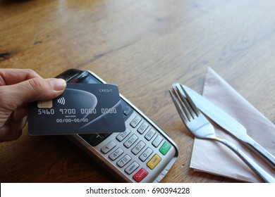 tap card pay chip pin - coronavirus covid 19 ban concept -contactless payment card pdq background copy space with hand holding credit card ready to pay at cafe stock, photo, photograph, picture