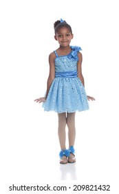 Tap Dancer.  Adorable little girl dressed in a dance outfit and tap shoes performing a routine.  Isolated on white.