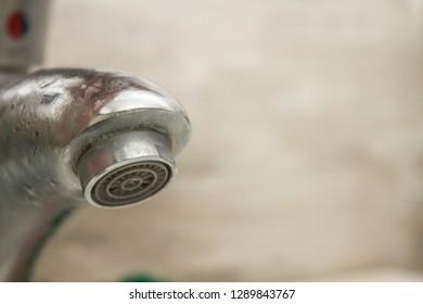 Tap head of a metal sink.