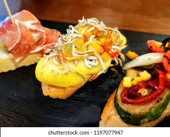 A tapa is an appetizer or snack in Spanish cuisine and translates to small portion of any kind of Spanish cuisine - tapas, tomato, cheese, fish, pork, beef, chicken, olive, paprika, jamon, seafood.