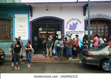 Tapachula, Chiapas/Mexico-May 15, 2019: A group of migrants wait outside the Human Rights Center to have their preliminary asylum status determined before going to the National Institute of Migration.