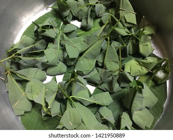 The 'Tapai pulut' that has been wrapped with green leaves that are still raw.
