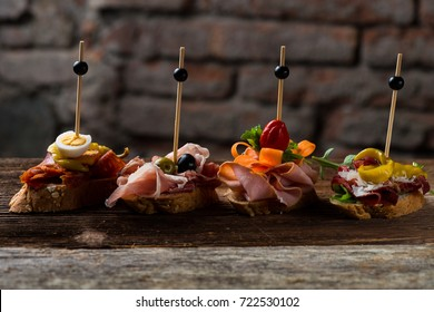 Tapas on Crusty Bread - Selection of Spanish tapas served on a sliced baguette.