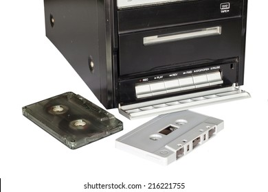 tape cassette and tape player on white background