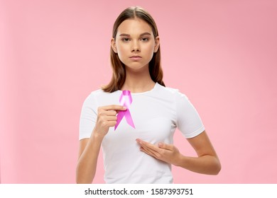 Tape in the hands of a woman oncology charity fund raising assistance - Shutterstock ID 1587393751