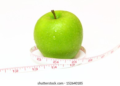 The tape measure of body good health with a green apple