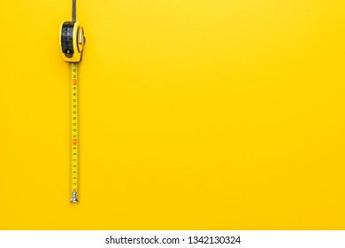 tape measure on the yellow background with copy space