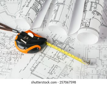 Tape measure over a construction plan drawing