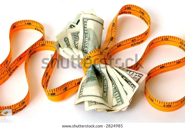 a tape measure pulled tightly around money