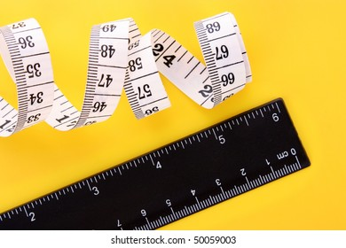 Tape measure  and ruler on yellow background