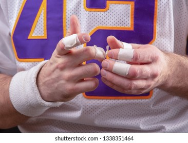 Taped fingers Of American footballer