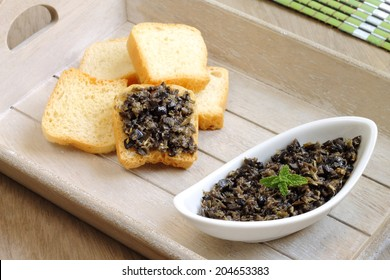 Tapenade, a traditional French dish consisting of pureed or finely chopped olives, capers, anchovies and olive oil