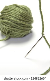 Tapestry Needle with Green Yarn on White