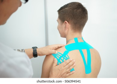 taping health spin male blue patch