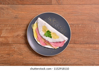 Tapioca filled with ham and cheese slices