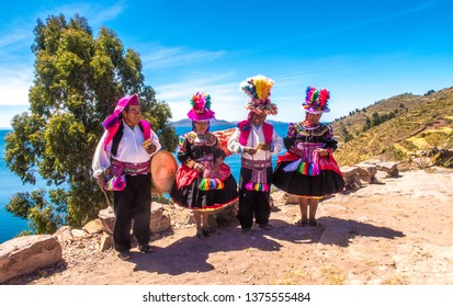 Taquile island / Peru - 11 04 2018: Traditional music and dance group
