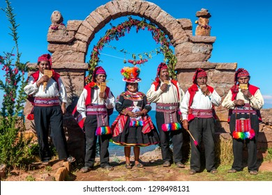 TAQUILE ISLAND, PERU - MAY 06, 2018:  Musicians and dancers in the peruvian Andes on Taquile Island. Puno, Peru.