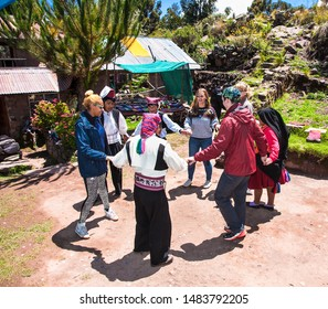 Taquile , Peru - Jan 5, 2019: Unidentified  Musician and dancers in traditional outfit specific for the Taquile Island. Peru.