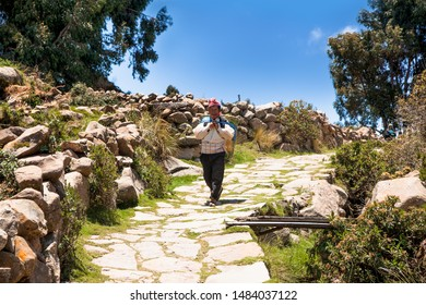 Taquile , Peru - Jan 5, 2019: Unidentified  Local residents of Taquile island in traditional outfit specific for the Taquile Island. Peru.