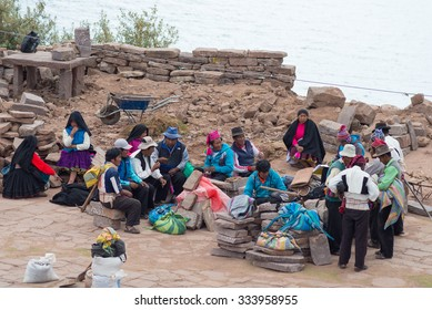 Taquile, Peru - September 1, 2015: Community of traditionally dressed people in Taquile Island, Titicaca Lake, Peru. About 2200 people live on the island. They speak Quechua language.