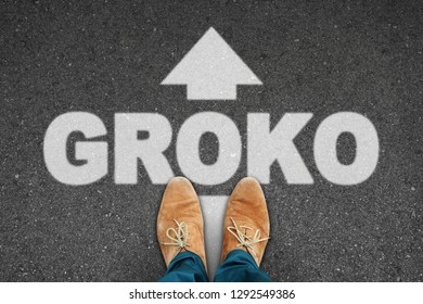 """tar road from above with men's slipper with text """"groko"""" (big coalition)"""