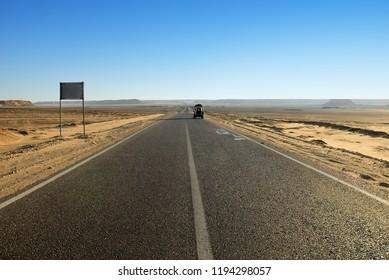 Tar road in Sahara desert between Dakhla and Farafra oasis. Egypt. Africa