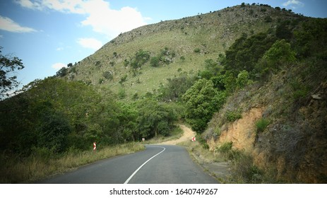 Tar road winding through hilly terrain on the Geo Trail, Mpumalanga