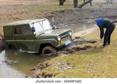 Taraclia, Moldova - 03. 05. 2017: Russian SUV, Off-road vehicle slips, Stuck in the river