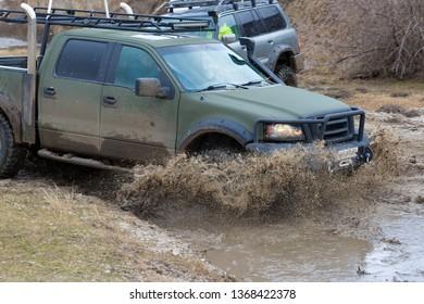 Taraclia, Moldova - 23. 02. 2019: Rally on Nissan SUVs in the mud in winter, All-terrain vehicle crosses the river