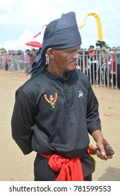 TARAKAN, INDONESIA, 17 DEC 2017 : male tribal kalimantan dressed in black and machetes Saber in Iraw Tengkayu Festival at Amal Beach Tarakan, Indonesia