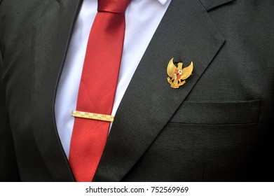 TARAKAN, INDONESIA, 17th August 2017 : suits of red tie men with the Garuda bird brooch of the Indonesian state emblem