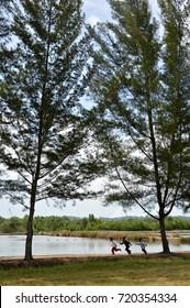 TARAKAN, INDONESIA - 30th MAY 2016 : Muslim boys race running by the pool